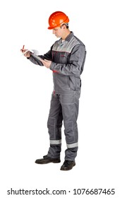 Full length portrait of a male builder over white wall background. repair, construction, building, people and maintenance concept.