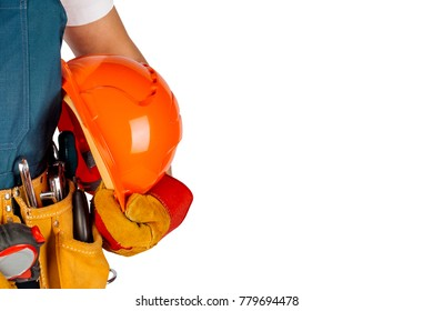 Full length portrait of a male builder in with helmet  over white wall background.