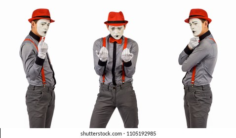 Full length portrait of a male clown, Mim. isolated on white background.