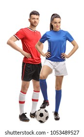 Full length portrait of a male and a female soccer player with a football isolated on white background
