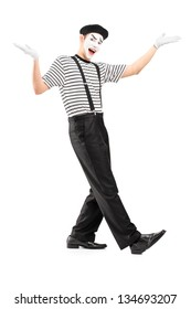 Full length portrait of a male mime dancer gesturing with hands isolated against white background - Shutterstock ID 134693207