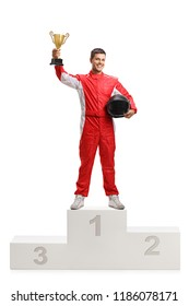 Full length portrait of a male racer winner on a winner's pedestal with a gold trophy cup isolated on white background