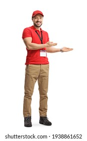Full length portrait of a male shop assistant gesturing welcome isolated on white background