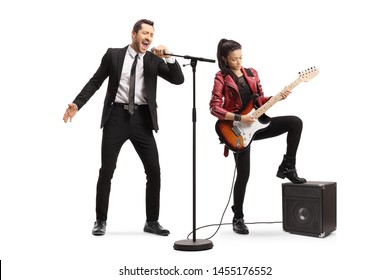 Full length portrait of a male singer singing and a young woman playing an electric guitar isolated on white background