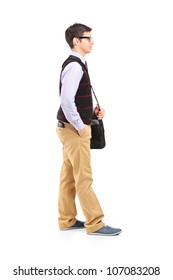 Full length portrait of a male student standing in line isolated against white background