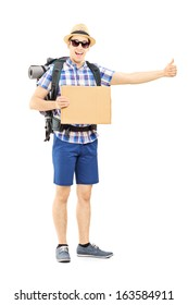 Full length portrait of a male tourist with backpack hitchhiking isolated on white background