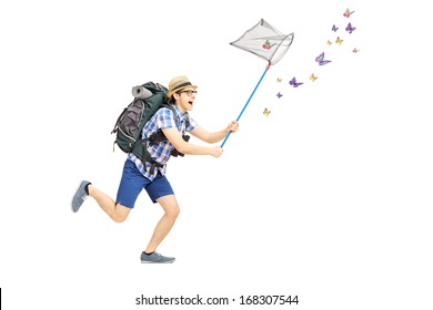 Full length portrait of a male tourist catching butterflies with net isolated on white background