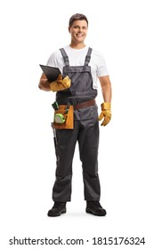 Full length portrait of a male worker with a tool belt holding a clipboard isolated on white background