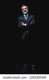 Full length portrait of Mature business man wearing formal suit standing on black background
