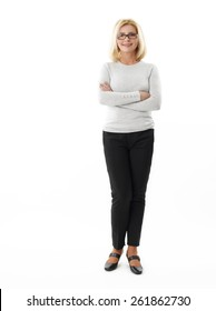 Full length portrait of mature business woman standing against white background.
