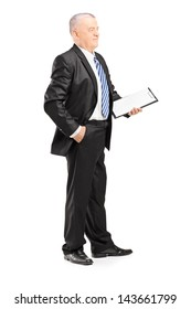Full length portrait of a mature businessman posing with clipboard isolated on white background