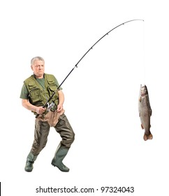 Full length portrait of a mature fisherman catching a fish isolated on white background