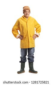 Full length portrait of a mature man in a yellow raincoat isolated on white background