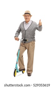 Full length portrait of a mature man with a scooter giving a thumb up isolated on white background