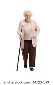 Full length portrait of a mature woman with a cane walking towards the camera isolated on white background