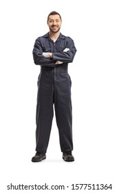 Full length portrait of a mechanic in a dark blue overalls isolated on white background
