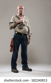 Full Length Portrait of Mechanic with an Industrial Chain and Hook