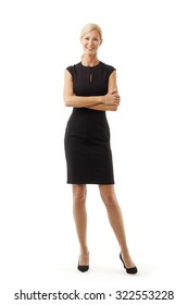 Full length portrait of middle age businesswoman standing against white background while looking at camera and smiling.