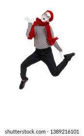 Full length portrait of mime woman artist jumping isolated on white background