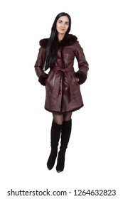 Full length portrait of modern young attractive brunette girl model in a maroon stylish demi-season leather coat. Women's seasonal fashion. Light overcoat. Isolated