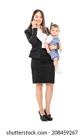 Full length portrait of a mother holding her daughter and talking on phone isolated on white background