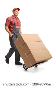 Full length portrait of a mover pushing a hand truck isolated on white background