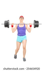 Full length portrait of a nerdy athlete attempting to lift a weight isolated on white background