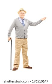 Full length portrait of an old man with cane gesturing with hand isolated on white background