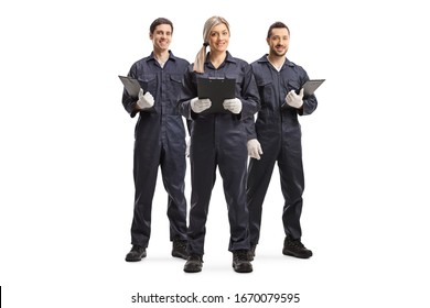 Full length portrait of one female and two male workers in overall uniforms isolated on white background