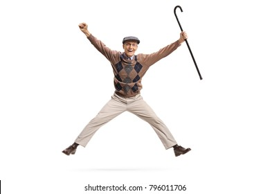 Full length portrait of an overjoyed senior with a cane jumping isolated on white background