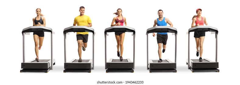 Full length portrait of people running on treadmills in a row isolated on white background