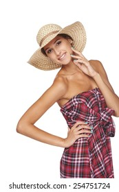Full length portrait of playful woman wearing chequered summer dress and broad-brim straw hat, isolated on white  background