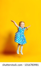 A full length portrait of a positive young pretty girl. Summer bright fashion for kids.