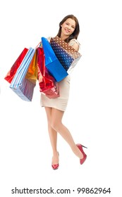Full length portrait of pretty young woman with colorful shopping bags. Isolated on white background