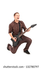 Full length portrait of a rock star playing a guitar isolated against white background