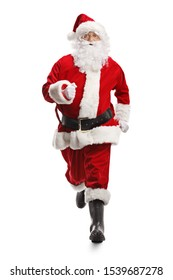 Full length portrait of Santa Claus running towards the camera isolated on white background