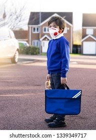 Full length portrait of  School wearing protective face mask for pollution or virus, Child in school uniform wearing protection mask while waiting for school bus in the morning.