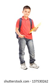 6f75f14d740 Full length portrait of a schoolboy with backpack holding a notebook  isolated on white background