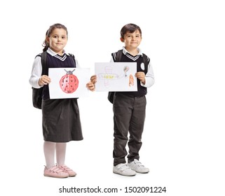 Full length portrait of a schoolchildren in uniforms holding drawings isolated on white background