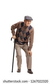 Full length portrait of a senior man with a knee pain walking with a cane isolated on white background