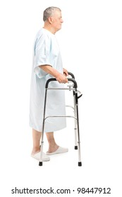 Full length portrait of a senior patient using a walker isolated against white background