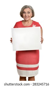 Full length portrait of senior woman holds banner in red dress on white background
