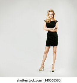 Full Length Portrait of a Sexy Blonde Woman in Little Black Fashion Dress