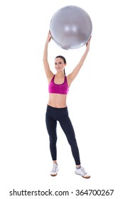 full length portrait of slim woman in sports wear with fitness ball isolated on white background