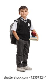 Full length portrait of a small schoolboy with a backpack isolated on white background