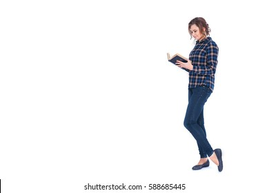 Full length portrait of a smiling beautiful woman student holding book isolated on a white background