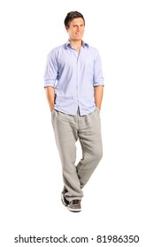 Full length portrait of a smiling casual man looking at camera isolated on white background