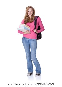 Full length portrait of smiling female college student with backpack and books standing against white background