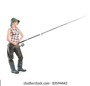 Full length portrait of a smiling fisherwoman holding a fishing pole isolated on white background