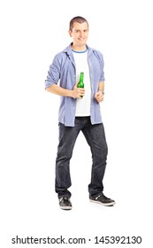Full length portrait of a smiling guy holding a beer bottle isolated on white background
